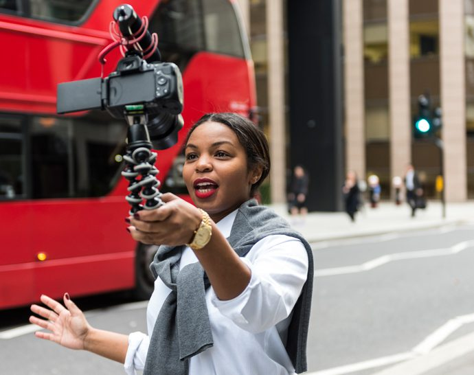 Woman filming herself on a street in London